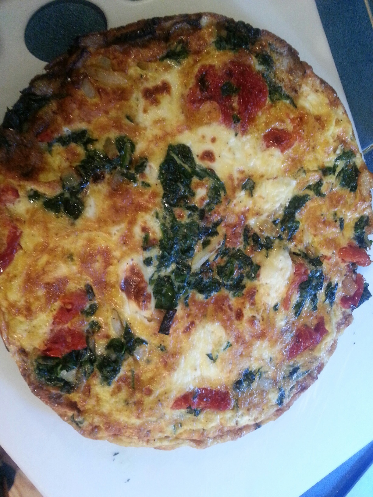 This recipe for Baby Spinach, Swiss, and Sun Dried Tomato Frittata, by ...