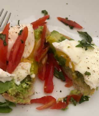 Pouched eggs with basil, tomatoes & avocado image
