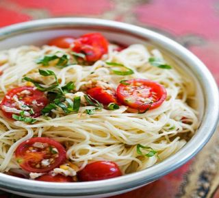 Angel Hair Pasta with Clams, Cherry Tomatoes, and Basil Recipe image